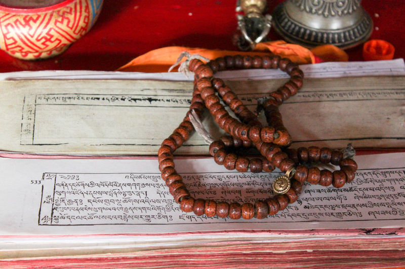 prayer chain Buddhism Temple Ladakh Buddhism Close-up Communication Day Food Freshness Gompa Indoors  No People Paper Table Text Thiksey Thikseymonastery