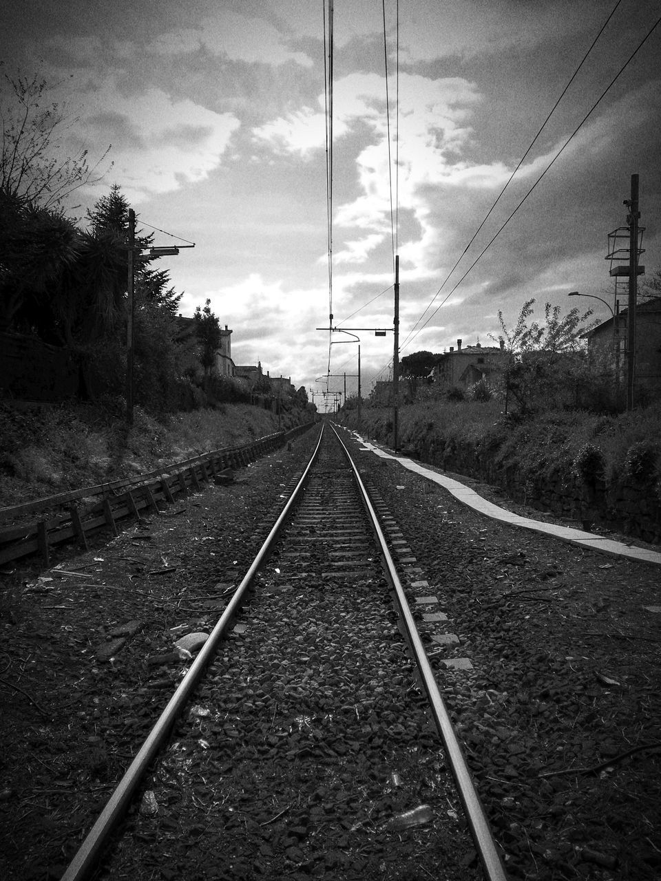railroad track, rail transportation, transportation, diminishing perspective, cable, sky, the way forward, no people, railway track, cloud - sky, electricity, electricity pylon, landscape, day, parallel, outdoors, nature