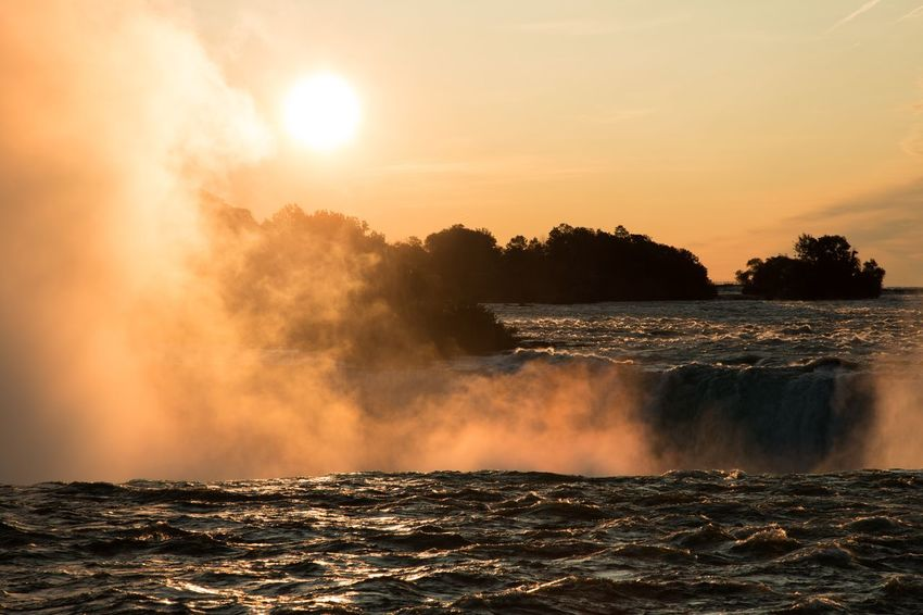 Niagara Falls EyeEm Selects Water Beauty In Nature Sky Sunset Scenics - Nature Nature Tranquil Scene Sun Idyllic Tranquility Power In Nature Orange Color Sunlight Motion Waterfront Non-urban Scene Outdoors No People