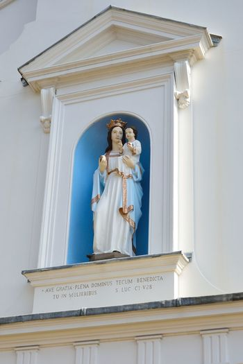 Statue of Madonna on wall Human Representation Religion Belief Representation Sculpture Architecture Female Likeness Religous Catholic Christian Statue Spirituality Madonna Madonna And Child Built Structure