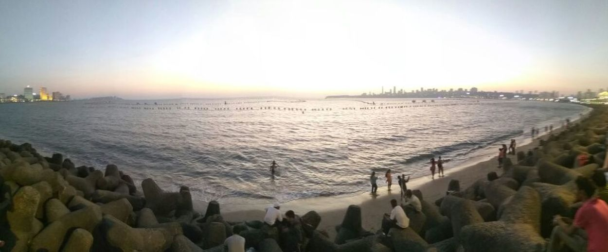 Sunset Water Sea Outdoors Tranquility Beauty In Nature City Nature Scenics Large Group Of People Sky Architecture People Day