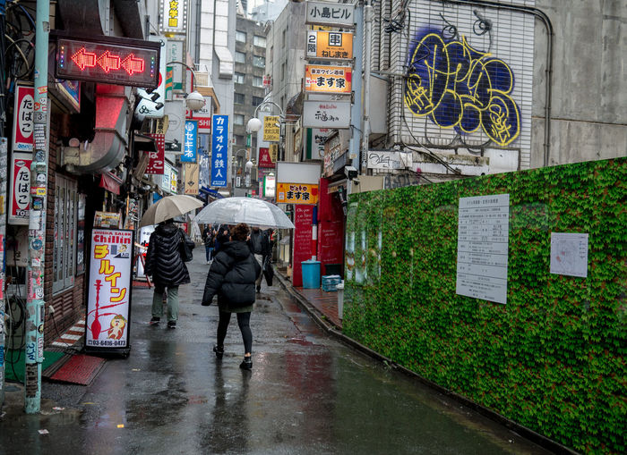 Rainy Tokyo day Adult Architecture Building Exterior Built Structure City City Life Lifestyles Men Monsoon Outdoors People Protection Rain Rainy Season Real People Rear View Street Umbrella Walking Wet