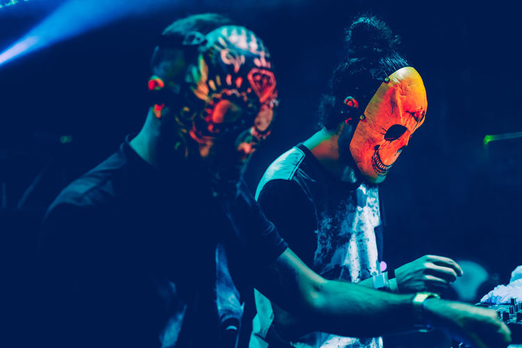 People wearing mask playing music