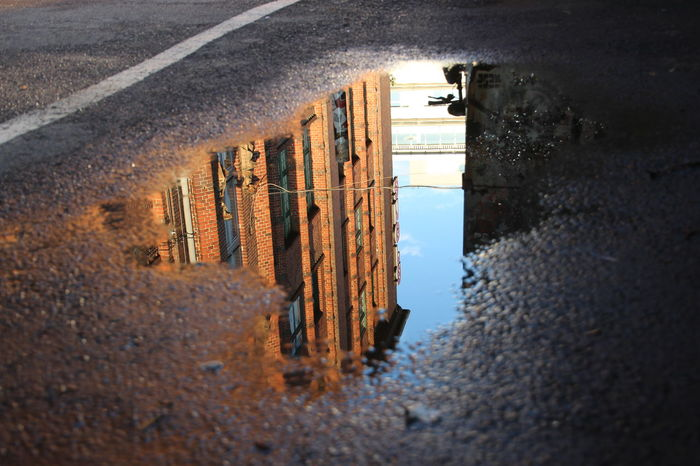 The hall of Arena Berlin reflected in the surface of the puddle. Art Berlin Cultural Heritage Eventlocation Historical Building Industrial Architecture Monument Open Space Spree Water Reflections Waterside Discover Berlin