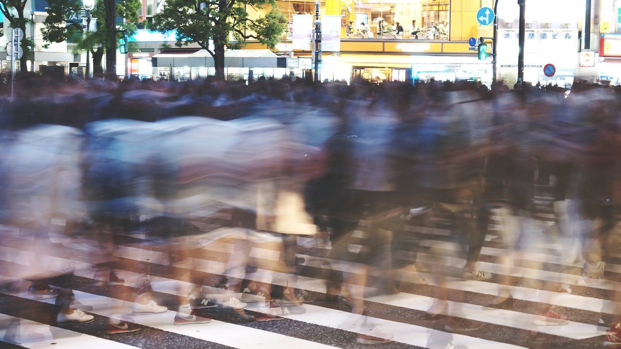 Blurred crowd on zebra crossing during rush hour