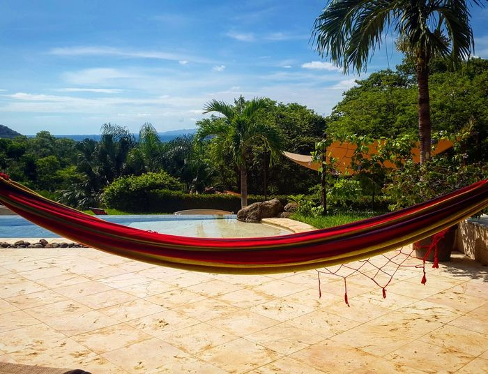 Hammock At Poolside Against Sky