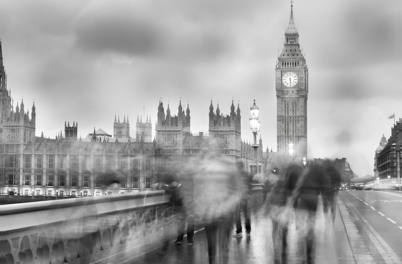 Blurred motion of people walking on westminster bridge