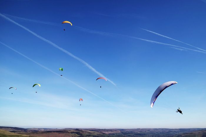 Parachute Extreme Sports Adventure Mid-air Leisure Activity Flying Paragliding Parasailing Sport Nature Outdoors Blue Low Angle View Real People Day Scenics Sky Lifestyles Peak District  Peak District National Park Beauty In Nature