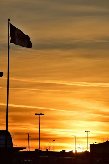 Beauty In Nature Canada Canada Flag Dark Flag No People Orange Color Outdoors Scenics Sky Sunset