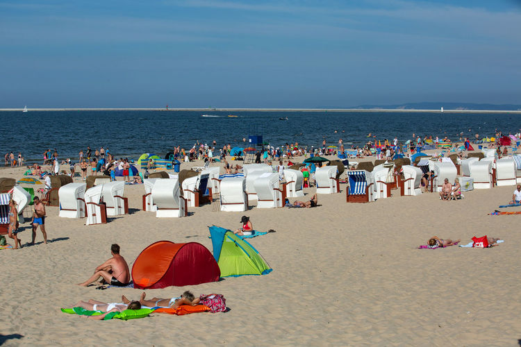 Baltic Sea Beach Beauty In Nature Crowd Group Of People Holiday Horizon Horizon Over Water Land Large Group Of People Nature Outdoors Real People Sand Scenics - Nature Sea Sky Summer Umbrella Vacations Water
