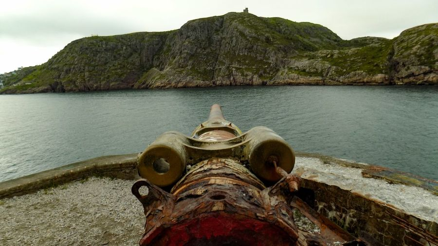 Cannon against sea and mountains