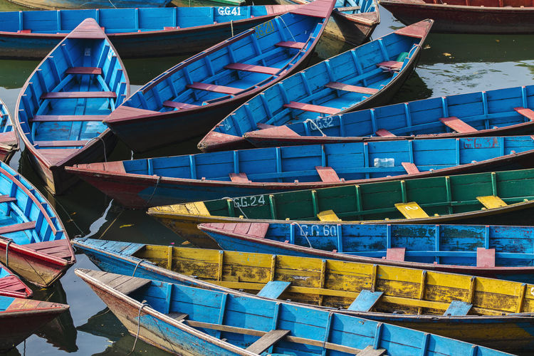 Multi colored boats moored in canal