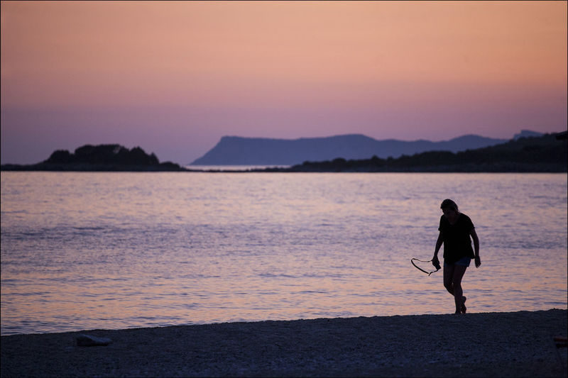 Sunset on Maga Ammos beach Coastline Landscape Corfu, Greece Mega Ammos Sivota Woman Adult Beach Beauty In Nature Leisure Activity Nature One Person Outdoors People Photographer Sea Seaside Silhouette Sky Sunset Vacations Water Woman Who Inspire You HUAWEI Photo Award: After Dark