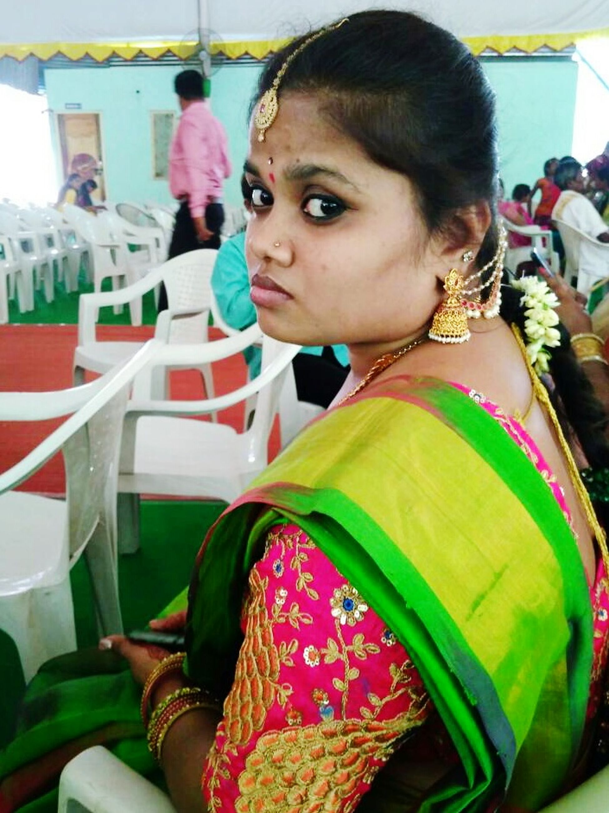 traditional clothing, incidental people, real people, one person, focus on foreground, beautiful woman, sari, young adult, fashion, lifestyles, side view, looking at camera, portrait, young women, day, indoors, close-up, people, adult