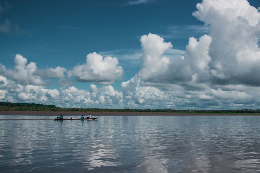 Sky Water Outdoors Day Reflection Nature Cloud - Sky Lake River Travel Destinations Adventure Amazon Rainforest Jungle South America Latin America Real People Mode Of Transportation Nautical Vessel Men Tranquil Scene Transportation Waterfront Beauty In Nature Tranquility Human Connection A New Perspective On Life Capture Tomorrow