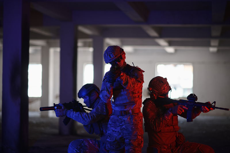 Soldiers standing with rifles on floor