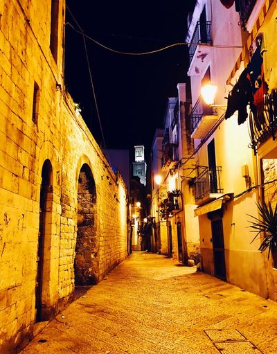 Walking in the old town Old But Awesome Old Town Old Buildings IPhoneography EyeEmNewHere Bell Tower Yellow Cathedral Star - Space Italy Night Architecture Building Exterior Built Structure Illuminated Street Light The Way Forward Street Outdoors No People City Sky