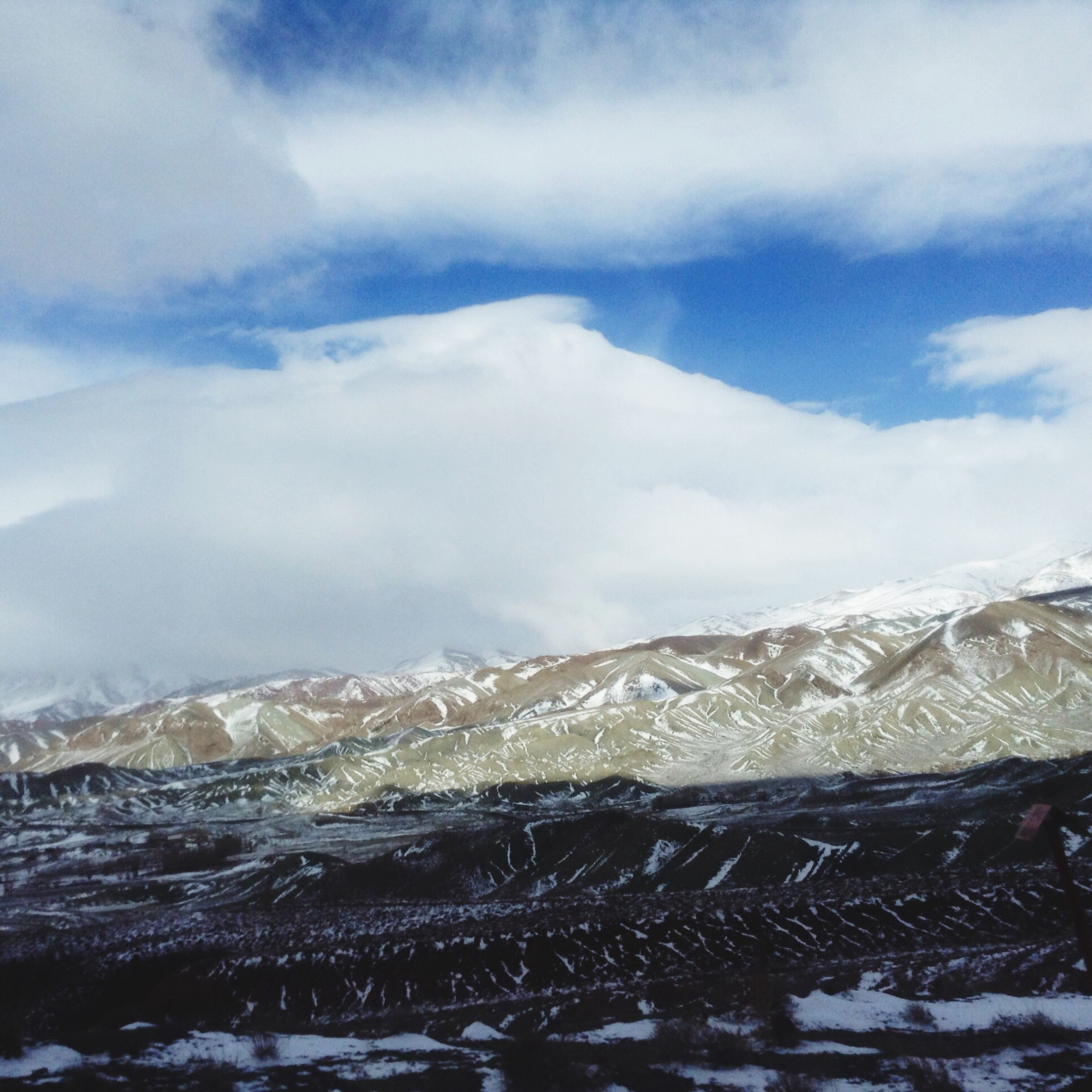 snow, winter, cold temperature, mountain, season, weather, snowcapped mountain, scenics, tranquil scene, covering, sky, mountain range, beauty in nature, tranquility, landscape, nature, frozen, cloud - sky, white color, snowcapped