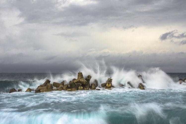 Stormy seascape Coast Havana Cuba Motion Blur Cloud - Sky Water Power In Nature Wave Sea Crash Motion Breaking RISK Spraying Sky Force Storm Cloud Hitting Storm Overcast Rough