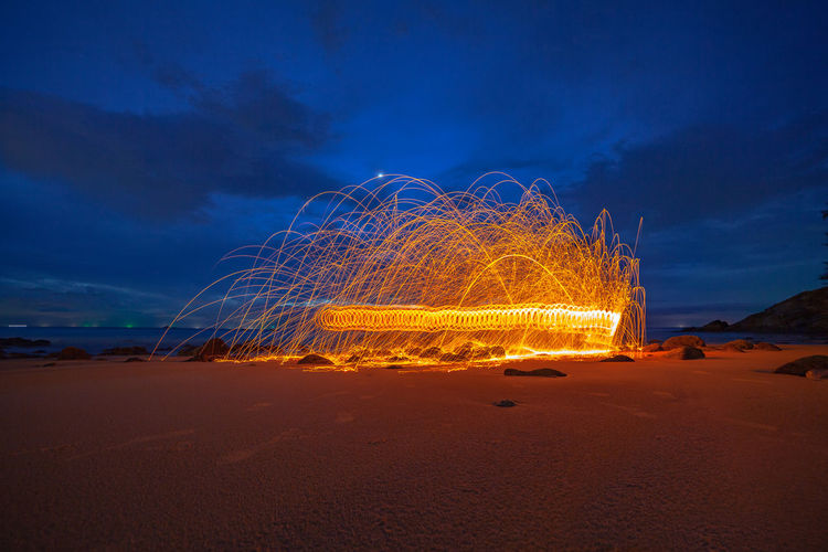 cool burning steel wool art fire work photo experiments on the beach at sunset Art Firworks, Firework, Sunset, Beach, Nature, Red, Spinning Light, Twight, Sky, Fire, Reflect, Sea, Star, Jewish, David, Symbol, White, Israel, Holiday, Background, Hebrew, Blue, Religion, Judaism, Decoration, Old, Art, Religious, Jew, Gold, Israeli, Ornament, Sign, Judaic, Isolated, Cemetery, Hexagram, Memorial, Star Of David, Vintage, Texture, Ancient Heart, Hot, Hot, Hot Steel Wool, Land Sky Night Heat - Temperature Long Exposure Cloud - Sky Illuminated Motion Sand Nature Beach No People Blurred Motion Glowing Outdoors Blue Fire Water Environment Burning Wire Wool