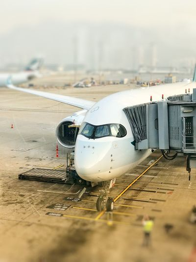 View of airplane at airport runway
