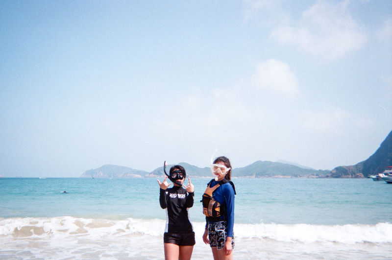 Sky Water Sea Two People Leisure Activity Standing Togetherness Beach Nature Real People Day Beauty In Nature Lifestyles People Young Adult Casual Clothing Land Looking At Camera Young Women Outdoors Positive Emotion Couple - Relationship
