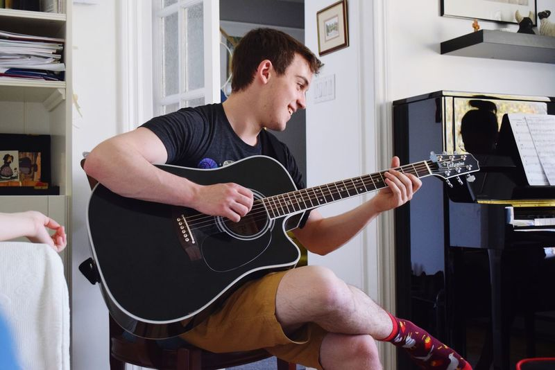Baby Accoustic Guitar Socks EyeEm Selects Musical Instrument Guitar Music Musical Equipment String Instrument Playing Musician Young Men One Person Indoors  Arts Culture And Entertainment Young Adult Guitarist Plucking An Instrument Home Interior Sitting Real People