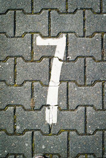 Directly above shot of number 7 on footpath