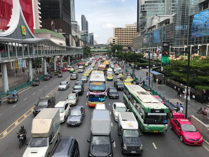 Traffic jam Transportation Mode Of Transportation Car Motor Vehicle City Land Vehicle Street Building Exterior Architecture Built Structure Incidental People Traffic Road Day City Street Nature Traffic Jam City Life High Angle View Sky