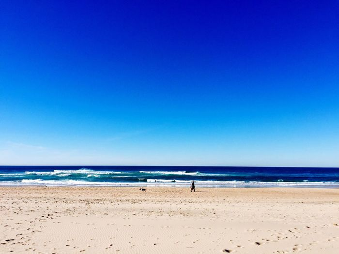 Portugal Beach Sand Sea Blue Horizon Over Water Nature Water Shore Copy Space Scenics Tranquility Beauty In Nature Tranquil Scene Vacations Day Outdoors Clear Sky Sky Wave No People Portugal Is Beautiful Loneliness