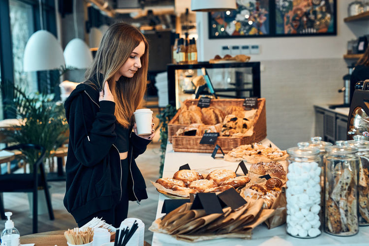 Woman standing by display at store