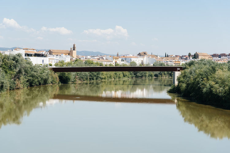 Bridge of Miraflores over Guadalquivir river in the city of Cordoba. Andalusia Córdoba Guadalquivir Architecture Bridge Bridge - Man Made Structure Building Exterior Built Structure City Day Nature No People Outdoors Reflection River Sky Town Tree Water Waterfront
