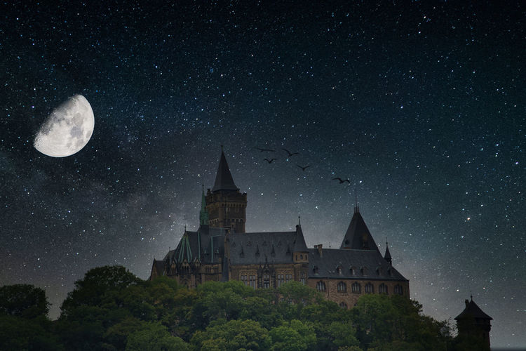 Low angle view of building against sky at night harz castle, castle,