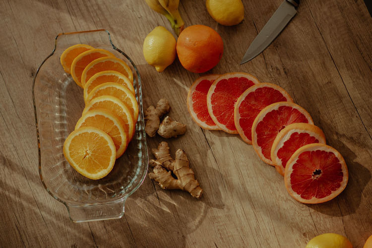 High angle view of oranges on cutting board