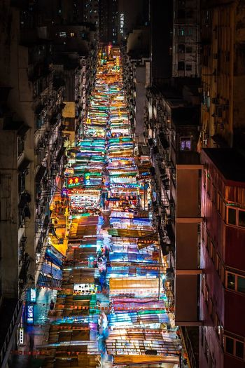 Soak up the atmosphere at the colourful Temple Street Night Market in Hong Kong, which comes alive when the sun goes down. Temple Street Night Market City Lights By Night City Lights Hong Kong Illuminated Multi Colored Night No People Arrangement Large Group Of Objects Retail