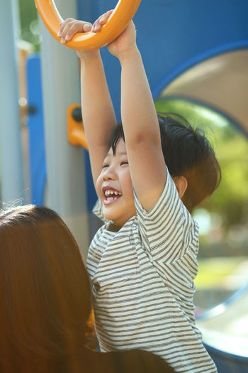 Asian kid having fun in the playground outdoor Moments Of Happiness