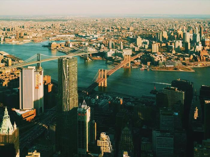 Aerial view of manhattan bridge and brooklyn bridge over east river in city