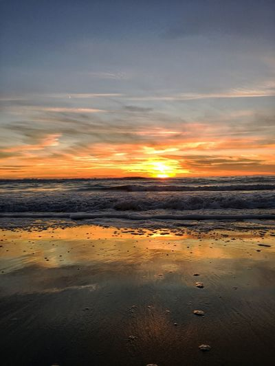 Sunset Beauty In Nature Orange Color Tranquility Nature Tranquil Scene Scenics Sky Beach No People Outdoors Water Sea Day