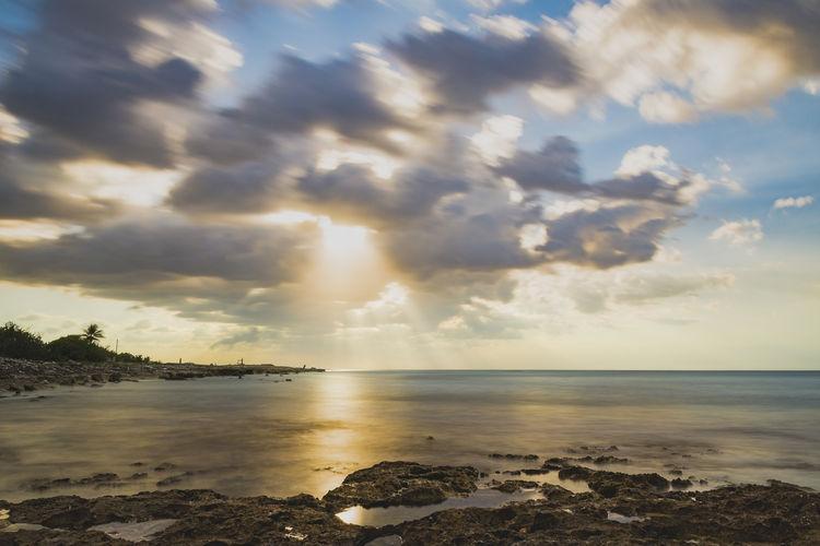 Clouds'n sun Long Exposure Water Sea Beach Sunset Sand Low Tide Dramatic Sky Sky Horizon Over Water Cloud - Sky Tide Coast Wave Coastline Atmospheric Mood Coastal Feature Shore Rocky Coastline Ocean