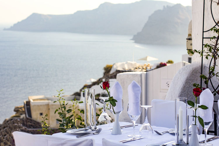Place Setting On Table Against Sea