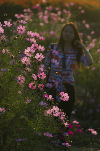 Flower Pink Color Nature Outdoors Tranquility Beauty Day Landscape Adult People One Person Only Women Beauty In Nature Flower Head