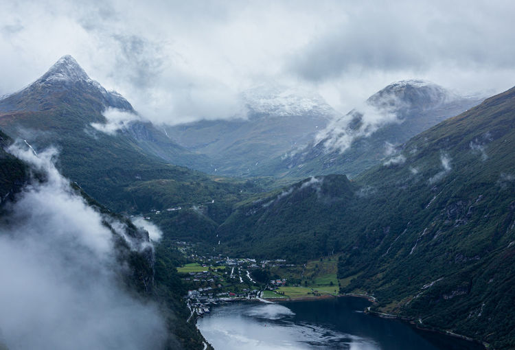 Scenic view of snowcapped mountains against sky, geiranger, norway
