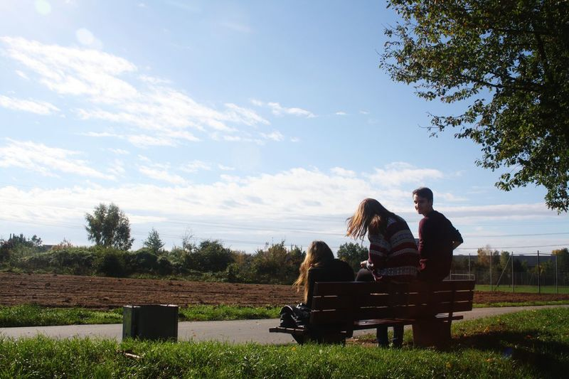 Sitting Bench Togetherness Tree Relaxation Person Couple - Relationship Lifestyles Sky Bonding Day Park - Man Made Space Casual Clothing Outdoors Cloud Park Bench Affectionate