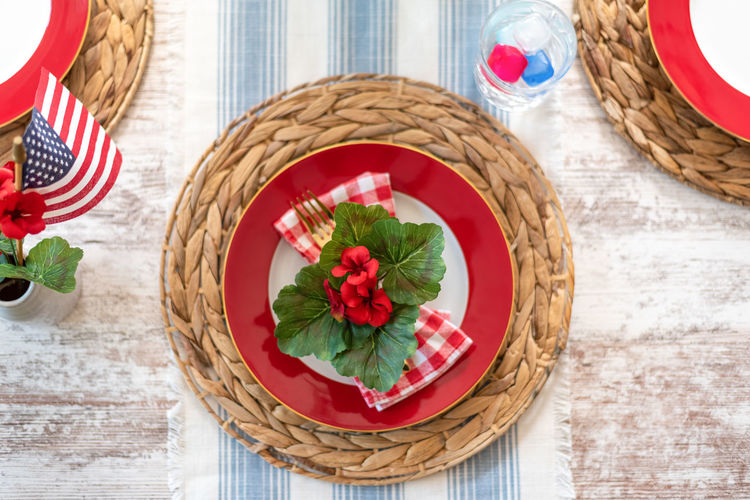 High angle view of red roses in basket on table