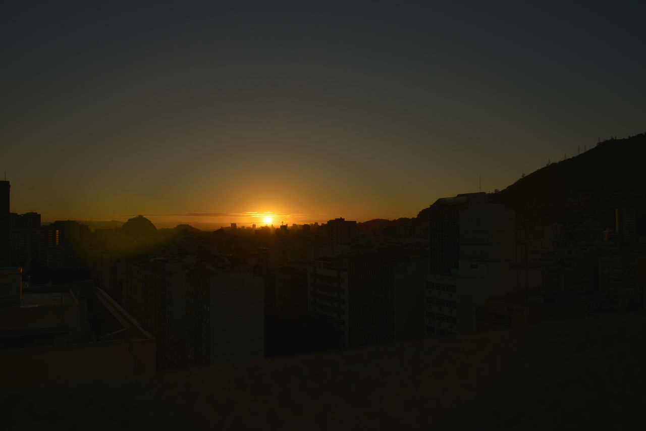 sunset, architecture, no people, city, night, building exterior, sky, outdoors, cityscape, clear sky, mountain, residential, nature