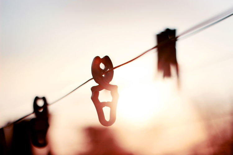 Close-up of clothespins on clothesline