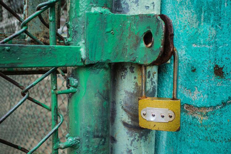 Close-Up Of Padlock On Gate