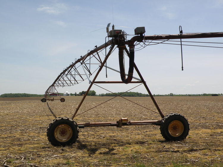 Precision irrigation technology allows farmers to boost corn/bean yields Day Environmental Conservation Farm Field Grass Grassy Irrigation Landscape Mode Of Transport Nature No People Non-urban Scene Outdoors Renewable Energy Rural Scene Sky Stationary Tranquility Wheel Windmill