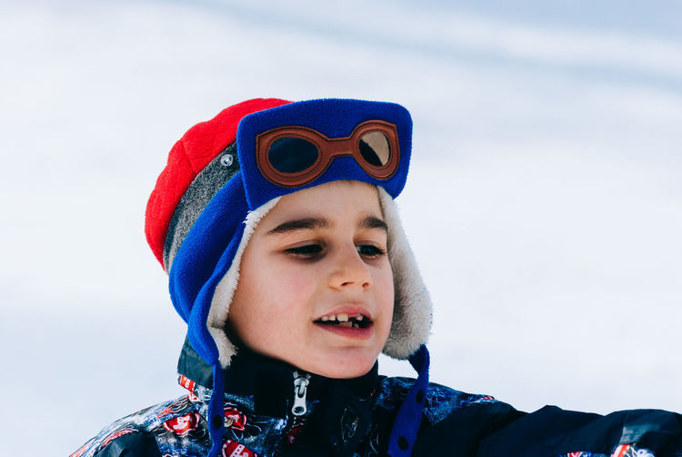 Boys Child Childhood Close-up Cold Temperature Day Focus On Foreground Front View Headshot Leisure Activity Lifestyles Nature One Boy Only One Person Outdoors People Portrait Real People Snow Vacations Warm Clothing Winter