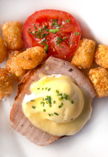 Eggs Benedict for Brunch Eggs Benedict Breakfast Bread Close-up DIP Eggs Benedict Food Food And Drink Freshness Healthy Eating High Angle View Indoors  No People Plate Ready-to-eat Red Serving Size